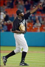 Florida pitcher Dontrelle Willis celebrates after a complete-game victory over Washington. The Marlins blanked the Nationals, 9-0, Friday in Miami.