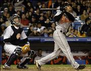 Baltimore's Brian ROberts watches his two-run home run sail over the right-field wall as New York catcher John Flaherty looks on. Roberts had four RBIs and finished a double short of the cycle in the Orioles' 12-5 victory Friday at Yankee Stadium in New York.