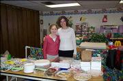Logan Masenthin, 11, and her mentor Beth Dwyer, of Eudora, are pictured at Logan's bake sale. She organized and sponsored a bake sale Feb. 27 at Immanuel Lutheran Church to raise money for the Lawrence Open Shelter/Drop-In Center. Her sale raised $167. Logan and Dwyer used the proceeds and donations they collected from church members to buy toiletries and food items for the shelter. The project was a service learning project for Immanuel Lutheran Church's early communion and Christian mentoring program. Logan's parents are Lee and Tricia Masenthin, Lawrence, and Doug and Melissa Jackson, Kansas City, Mo.