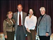 David Ambler, president of the 2004 United Way of Douglas County board, recognizes board members who ended their terms in March. From left are Judy Billings, Ambler, Betty Morris and Dee Bisel. Not pictured are Al Ballard, Mike Maddox and Jessica St. Clair. The group gathered for the United Way of Douglas County's annual meeting Feb. 24 at the Lawrence Arts Center, 940 N.H.