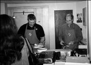 Brian Walter, left, and Steve Menke serve food during the Knights of Columbus Council 1372 breakfast at St. John the Evangelist Catholic Church. The March 13 event raised money for scholarships. The Knights present two $500 scholarships each year. One goes to a graduating high school senior who is Catholic. The other goes to a Knight or family member.
