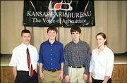 From left, Curtis Wakeman, Chris Orlando, Frank Male and Joanna Wakeman, all of Douglas County, attend Kansas Farm Bureau's annual Capitol Experience program. The program was Feb. 23 in Topeka. It is designed to provide students a firsthand look at Kansas government. The group had breakfast with the legislators, toured the Capitol, attended committee meetings and observed the House and Senate in session. They were sponsored by Douglas County Farm Bureau.