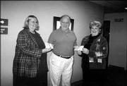 Grand Knight John Callewaert, center, presents checks to Barbara Bishop, left, of ARC of Douglas County, and Peggy Wallert, of Cottonwood Inc. The organizations each received $1,853.65. The Knights donated money that was raised during October's Tootsie Roll drive.