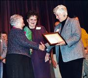 Lenora Crumet, left, volunteers for the Douglas County Visiting Nurses Assn., receives recognition as a Wallace Galluzzi 2004 Volunteer of the Year honoree at the United Way of Douglas County annual meeting. Marie Galluzzi Potter, center, and Dee Bisel presented Crumet with flowers and a certificate Feb. 24.