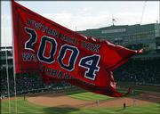 A flag proclaiming the BoSox the 2004 World Series champions, in top photo, also was unveiled in a pregame ceremony Monday in Boston.