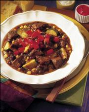 Mexican beef stew is typical of traditional cowboy fare: one-pot, slow-simmered foods, ready when the wranglers packed it in at the end of the day -- not unlike what the busy family needs today.