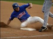 Kansas University base-runner Matt Baty slides back into first base against Baylor. Baty was 1-for-3 in the Jayhawks' blowout 13-2 loss to the Bears on Saturday at Hoglund Ballpark.
