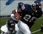 Kansas defensive back Aqib Talib (28) returns an interception against the White team in the spring game. Talib had two interceptions in Saturday's game -- a 24-6 Blue team victory -- at Memorial Stadium.