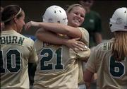 Baylor's Stephanie Pomes (21) and Chelsi Lake hug after Pomes scored a run in the third inning of the Bears' 8-7 victory. Baylor won Saturday at Arrocha Ballpark.