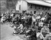 "Friends and relatives of miners trapped underground during the Sunshine Mine fire wait for word in this file photo from May 1972, in Kellogg, Idaho. Seattle author Gregg Olsen has written the book ""The Deep Dark,"" which tells the story of the disaster that claimed 91 lives."