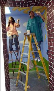Charnell Toshavik, left, and Byllye Jo Clendon, both seventh-graders at Central Junior High School, paint in the school's Sun Room.