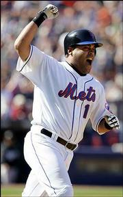 Ramon Castro celebrates his game-winning single for New York. The Mets defeated Florida, 4-3, Saturday in New York.