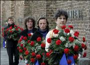 Women carrying wreaths walk in front the Wall of Nations during the commemoration ceremony marking the 60th anniversary of the liberation of the Nazi concentration camp of Ravensbrueck in Fuerstenberg, Germany. About 450 survivors gathered Sunday to commemorate the liberation by the Soviet Army in April 1945.