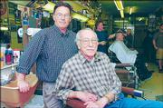 MIKE AMYX AND HIS FATHER, TOM AMYX, have a long history of cutting hair in Lawrence. Tom's father, Cecil, began cutting hair more than 80 years ago in a North Lawrence barbershop.
