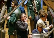 A trader watches stock prices from the floor of the New York Stock Exchange. Stocks plunged Wednesday on a Labor Department report that overall consumer prices jumped 0.6 percent in March, the biggest surge in five months.