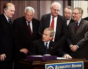 President Bush signs the Bankruptcy Abuse Prevention and Consumer Protection Act of 2005 Wednesday in the Eisenhower Executive Office Building in Washington. Behind Bush are, from left, Rep. Steve Chabot, R-Ohio; House Speaker Dennis Hastert, R-Ill.; Rep. James Sensenbrenner, R-Wis.; Sen. Chuck Grassley, R-Iowa; and Sen. Mitch McConnell, R-Ky.