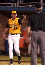 Wichita State assistant coach Brent Kemnitz argues with an umpire during the Shockers' 11-9 victory. WSU won Wednesday at Hoglund Ballpark.
