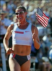 Stacy Dragila celebrates after winning the pole vault during the Olympic Track and Field trials. Dragila, who won the event in July in Sacramento, Calif., will compete Saturday in the Kansas Relays.