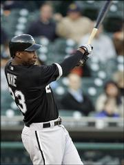Chicago's Jermaine Dye connects for a two-run home run against Detroit. The White Sox defeated the Tigers, 9-1, Wednesday night in Detroit.