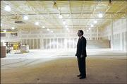 Miles Schnaer inspects his new showroom floor at the former Payless Cashways building.