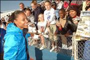 "Marion Jones jogs past a throng of fans after her 800-meter relay run at the Kansas Relays. Jones&squot; team was disqualified for a mistake on a baton pass.<br> <a href= ""http://www2.kusports.com/photos/galleries/2005/apr/23/2005_kansas_relays_saturday_events/292/"" target=""_new"" onclick= ""window.open(&squot;http://www2.kusports.com/photos/galleries/2005/apr/23/2005_kansas_relays_saturday_events/292/&squot;,&squot;Photo&squot;,&squot;height=650,width=550,screenX=10,screenY=10,&squot; + &squot;scrollbars,resizable&squot;); return false;""> <img src=""http://www.ljworld.com/art/icons/icon_photo.gif"" border= ""0"" alt=""photo""> Photo Gallery: 2005 Kansas Relays -- Saturday Events</a>"