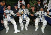Italian astronaut Roberto Vittori, left, Russian cosmonaut Salizhan Sharipov, center, and American astronaut Leroy Chiao shake hands shortly upon their arrival to the town of Arkalyk, northern Kazakhstan. The trio returned from the International Space Station early today.