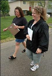 Sisters Missi Pfeifer, left, and Kelli Duncan walk the streets in the Pairie Park neighborhood, trying to collect signatures on a petition to keep a child predator, Leroy Hendricks, from moving to Lawrence.