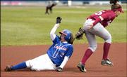 Kansas University's Nettie Fierros slides past Arkansas shortstop Dayne Huckabee for a stolen base. The Jayhawks swept the Razorbacks, 7-2 and 6-5, Tuesday at Arrocha Ballpark.