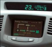 A monitor shows the energy status of one of the city's Toyota Priuses. Hybrids use an electronic motor until the cars get up to about 25 miles per hour, then they switch to the gasoline engine.