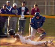 KU catcher Sean Richardson catches the ball at third base as Kansas State's Terry Blunt safely slides into the bag. The Wildcats routed Kansas, 7-0, on Friday in Manhattan.