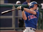 Kansas University's A.J. Van Slyke swings through a pitch during the Jayhawks' 7-0 loss to Kansas State. The Jayhawks dropped the series opener Friday in Manhattan.