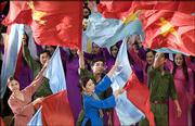Vietnamese perform during celebrations at National Assembly in Hanoi, Vietnam. Today is the 30th anniversary of the end of the Vietnam War.