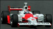 Marlboro team penske driver Sam Hornish Jr. steers his Dallara Toyota through a turn during qualifying for the Indy Japan 300. Hornish captured the pole position Friday for today's race on the 1.5-mile oval track at Twin Ring Motegi in Motegi, northeast of Tokyo.