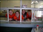 Douglas County 4-H'ers work in the Lawrence Flower Lawn & Garden Show's concession stand to raise money for their trip to Washington, D.C. These youths will spend seven days in Washington, D.C., learning about government and seeing historic sites. From left are Alison Mesler, Alyssa Golden, Mary Cox and Kaleb Horne.