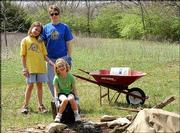From left, Gabi, Rebecca and Elizabeth Gant take a break from helping clean April 10 at Hidden Valley Camp in Lawrence. The camp was established for Girl Scout use in 1956.