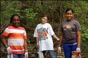 From left, Girl Scouts Mariam Ali, Devon Lohrenz and Raven Graves help during a spring cleanup at Hidden Valley Camp, just northwest of Kasold Drive and Bob Billings Parkway. The work day was April 10.