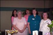 The Lawrence Soroptimist Club sponsored an afternoon tea with Altrusa International Inc. of Lawrence and the Lawrence Pilot Club. The event was April 9. From left are Michelle Heller, Dottie Nordlund, Connie Boring, Linda Mullens and Barbara Murphy. Boring is the president of the Lawrence Soroptimist Club.