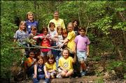 Girl Scout Troop 656 leaders Trish Pflummerfelt, back row left, and Debby McNemee, back row right, and their Scouts helped during a spring cleanup April 10 at Hidden Valley Camp, just northwest of the corner of Kasold Drive and Bob Billings Parkway.