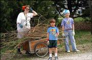 From left, Elizabeth Edens, Cameron Edens and Olivia Marshall, all of Lawrence, load brush during spring maintenance day at Hidden Valley Camp in Lawrence. Friends of Hidden Valley organized the April 10 cleanup day.