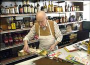 Ben Rich prepares a display of the cards in his grocery store, in St. Joseph, Mo., March 31. Rich said he had received birthday cards for his 90th birthday from people he had not heard from in years. Rich's store has been in business for more than 50 years.