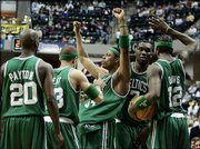 The Boston celtics, from left, Gary Payton, Delonte West, Paul Pierce, Al Jefferson and Ricky Davis celebrate after Pierce was fouled while hitting a three-point shot in the fourth quarter. Pierce scored 30 points as Boston defeated Indiana in Game 4 of their first-round playoff series, 110-79, Saturday in Indianapolis.