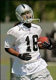 Oakland receiver Randy Moss carries the ball during minicamp. Moss, acquired in a trade with the Minnesota Vikings, worked out Friday at Raiders headquarters in Alameda, Calif.
