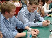 Free State High seniors Chris Sellon, left, and Anthony Portela laugh during the Lawrence Aquahawks award banquet. The swimmers signed college letters of intent during the dinner Tuesday at the Douglas County Fairgrounds.