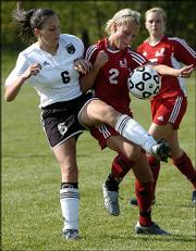 Free State High's Alexa Moreno (6) battles Olathe North's Brittany Tracz for control of a possession during the second half of the Firebirds' 5-0 loss. FSHS fell Thursday at Free State.