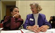 Kansas Board of Education members Connie Morris, left, and Kathy Martin laugh at a question posed during the first day of evolution hearings at Memorial Hall in Topeka. Morris and Martin are both conservative members of the board. Morris praised the testimony of evolution critics Thursday.