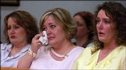 Carmin D. Ross' sisters, from left, April Russell, Heather Bowman and Samantha Fabbri, tear up as convicted murder and former Kansas State University professor Thomas E. Murray enters the courtroom in shackles. Murray was sentenced Friday to life in prison with no chance of parole for 25 years for Ross' murder in November 2003 at her Douglas County home.
