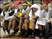 Indiana Pacers, from left, Stephen Jackson, Anthony Johnson, Jermaine O'Neal, Jamaal Tinsley and Reggie Miller watch from the bench during the closing minutes of their 96-81 loss to the Pistons. The Pacers fell Monday in Auburn Hills, Mich.