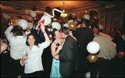 Midnight Revelers ring in a new millennium on Jan. 1, 2000, at the Eldridge Hotel.