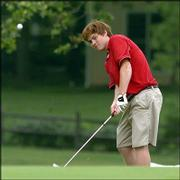 Lawrence High's Austin Rueschhoff chips onto a green during his round of 91 at the Lawrence Invitational.
