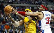 Detroit's Rasheed Wallace, right, reaches in on Indiana's Jermaine O'Neal. The Pacers beat the Pistons, 92-83, tying the series at 1 Wednesday in Auburn Hills, Mich.